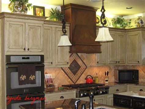 antique finish kitchen cabinets lynda bergman decorative artisan faux quot antique copper