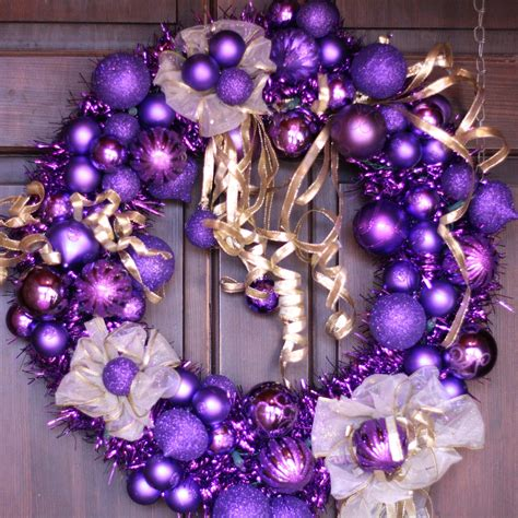 purple and gold christmas wreath with white lights holiday