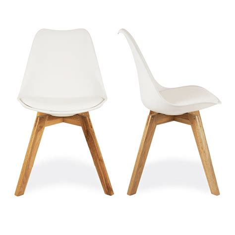 white desk with wooden legs charles eames x2 style white dining chairs with solid oak
