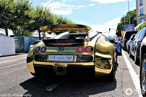 gold and black bugatti golden bugatti veyron spotted in geneva