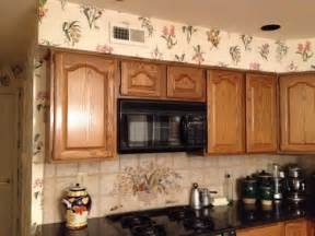 how to remove soffit above kitchen cabinets unsightly kitchen soffits cabinets