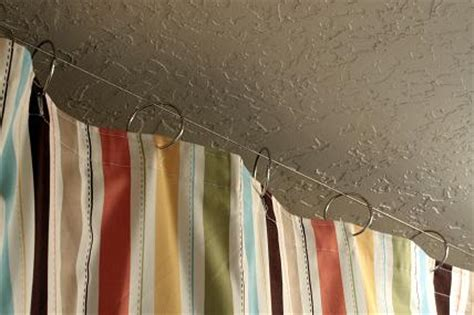 how to hang curtains from the ceiling hang ceiling mounted shower curtains vanilla joy
