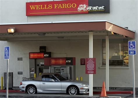 wells fargo agrees  pay   settle car loan lawsuit