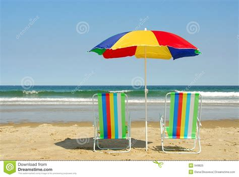 Surf The Web With The Umbrella by Chairs And Umbrella Royalty Free Stock Photo Image