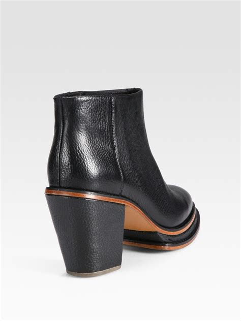 comey boots lyst comey twotone leather ankle boots in black