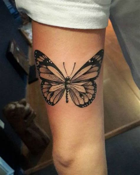 butterfly tattoo playing peekaboo on your back 50 gorgeous butterfly tattoos and their meanings you ll