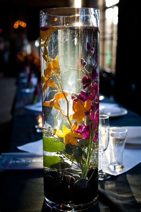 submersible flower centerpieces 1000 ideas about submerged flowers on floating candle centerpieces floating