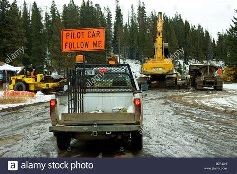 me a truck a pilot car truck carrying a pilot car follow me sign