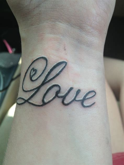 my wrist tattoo to write love on her arms wrist tattoo