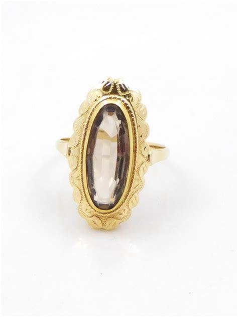 gold ring with light smoky topaz catawiki