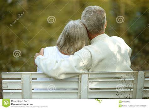 couple sitting on bench senior couple sitting on bench stock photo image 61009415