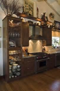 Decorating Kitchen Cabinet Tops the shorter cabinetry i wouldn t want to call attention to it by