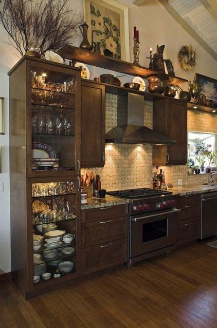 Decorate Kitchen Cabinets | how to decorate the top of a cabinet and how not to