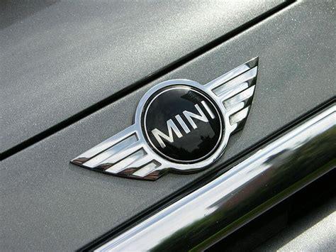 mini car logo mini cooper logo design history and evolution