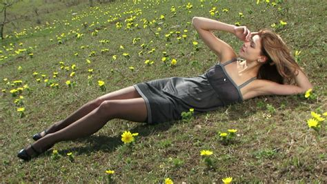 Stocking Ideas woman putting on black stockings in a field black