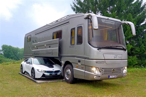 volkner mobil fancy 163 1 2million motorhome has its own supercar garage