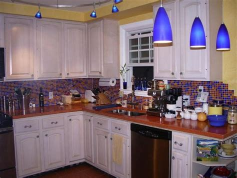 Blue Backsplash Kitchen When There S Much Going On Yellow Walls Blue Lights Orange Counters Blue And Orange
