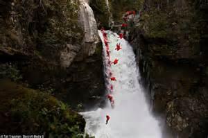 extreme kayaker takes  base jumper  race   bottom