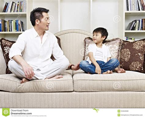 having on couch father and son royalty free stock photos image 32464568