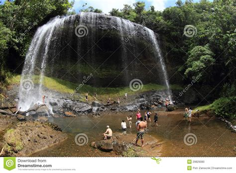 Bath Shower Seats waterfall in jungle with people editorial image image