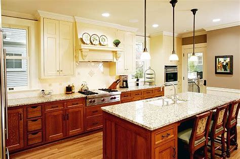 different colored kitchen cabinets love two different colored cabinets but i m thinking