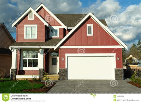 red house new red house home with white trim stock photo image