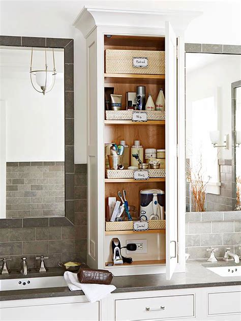 15 ways to organize bathroom cabinets vertical storage low shelves and electrical outlets