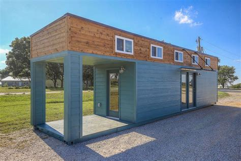 not buying anything density efficiency and tiny homes this amazing tiny home with porch is actually a 40 foot