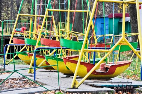boat swing swing boats in the old amusement park stock photo