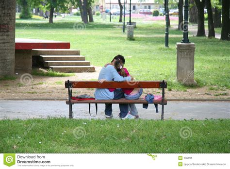 kissing bench a couple kissing on a bench stock image image 136691