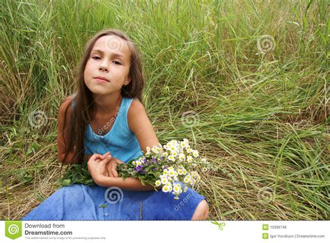 youth and beauty pretee preteen girl on grass background royalty free stock image