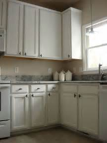 old oak cabinets painted white and distressed hometalk cheap ways to make your kitchen look expensive