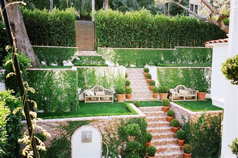 tiered backyard landscaping ideas awesome tiered garden brick stairs grass patches vine covered walls cococozy