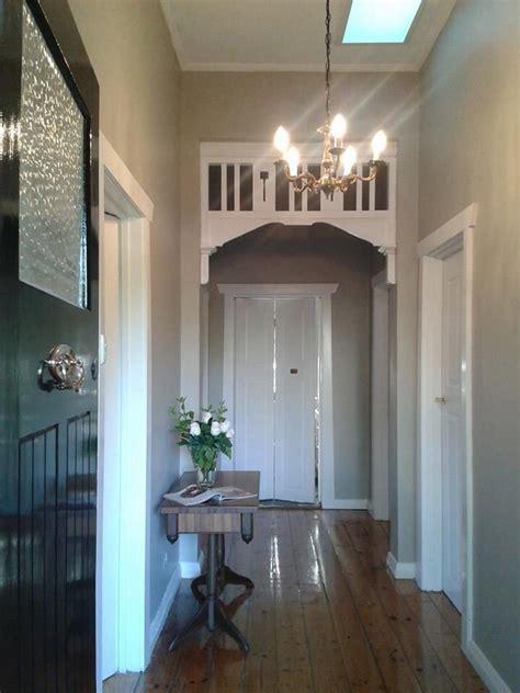 taupe stone walls  white trim black door home