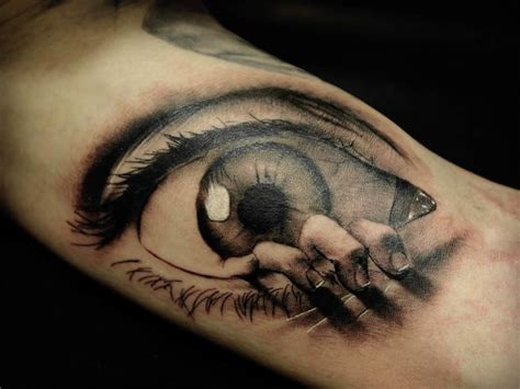 tattoo hand and eye who shot the statue of liberty tattoo piercings and 3d