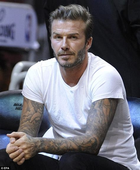 david beckham greeted by fans at miami basketball game