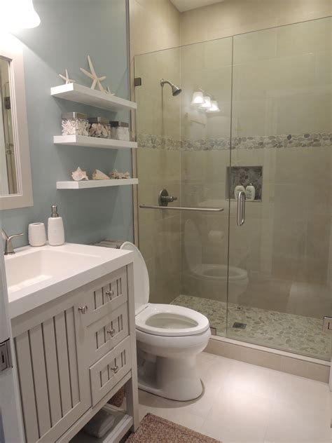 themed bathrooms beach theme bathroom stone shower floating shelves