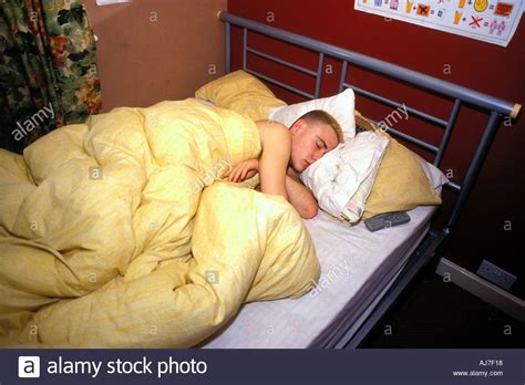 15 year old bedroom 15 year old boy asleep in his bed in bedroom uk stock