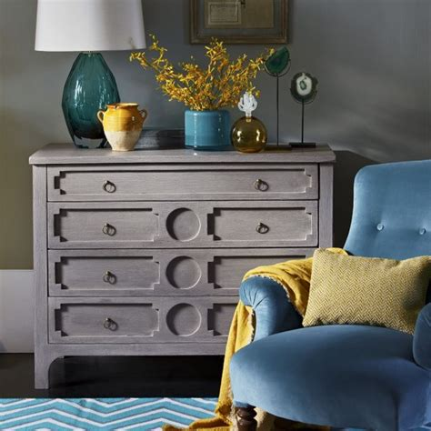 Corner Drawers Bedroom by Bedroom Corner With Chest Of Drawers And Teal Armchair