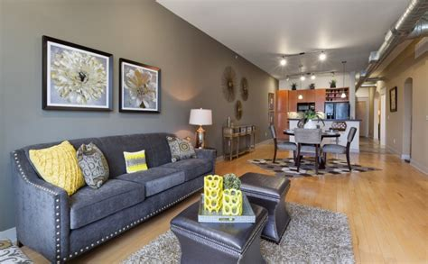 yellow sofa dark pillows dark rug grey cabinet and black dark gray couch ideas for appealing living room decohoms