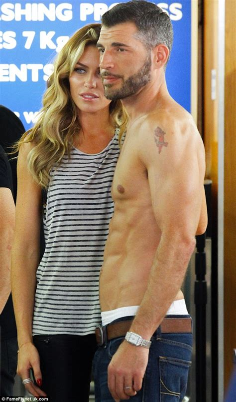 hot office tv abbey crouch frolics with topless male models on set of