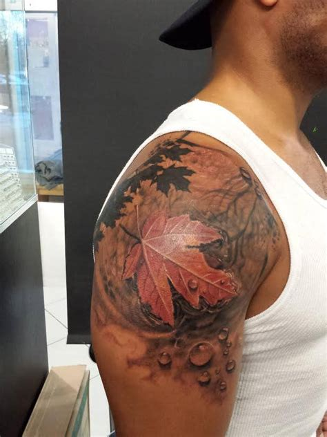 colour maple leaf tattoo on the shoulder chronic ink