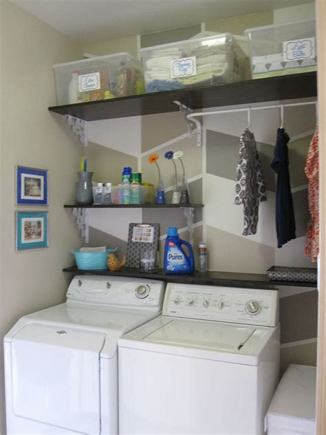 laundry room shelves hometalk 124 laundry room overhaul pass through to garage custom diy shelves labels