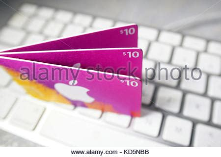 Computer Gift Cards - itunes gift card to download music on audio device stock photo royalty free image