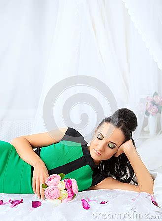 girl lying bed with flowers beautiful lady stock photo image 49670691