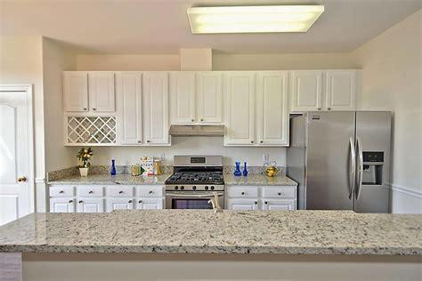 white cabinets with dallas white granite dallas white granite kitchen transitional with stone and