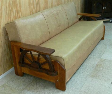 wagon wheel couch vintage wagon wheel with cow head sofa