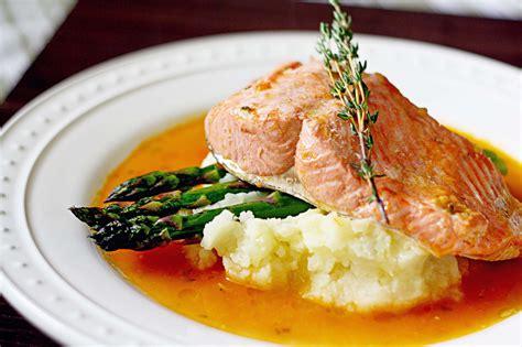 poached salmon poached salmon in tomato garlic broth steele house kitchen