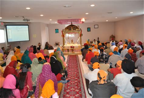 a bowing in respect to shri guru granth sahib inside a sikh temple nathan and darlene