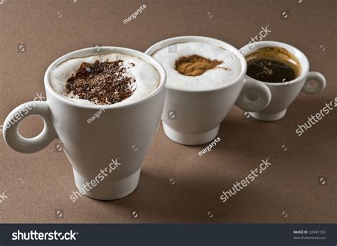 Moccachino Coffee Latte three coffee cups with espresso cappuccino mochaccino brown background stock photo